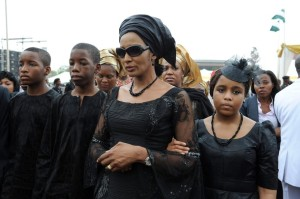 The widow of Nigeria's seccessionist leader Odumegwu Ojukwu, Bianca Ojukwu (C), and her children arrive to attend  the national inter-denominational funeral rites at Michael Opkara Square in Enugu, southeastern Nigeria, on March 1, 2012. Soldiers fired a 21-gun salute at the funeral of Odumegwu Ojukwu on Thursday as Nigerian leaders paid final respects to the man whose 1967 declaration of Biafran independence sparked a civil war. Forty-five years after he tried to split Nigeria asunder by proclaiming the Republic of Biafra, Ojukwu's coffin was draped in the national colours of white and green at the funeral service in the city of Enugu, attended by thousands.  Ojukwu died in November in Britain at the age of 78 but his body was only flown back on Monday. AFP PHOTO/ PIUS UTOMI EKPEI (Photo credit should read PIUS UTOMI EKPEI/AFP/Getty Images)