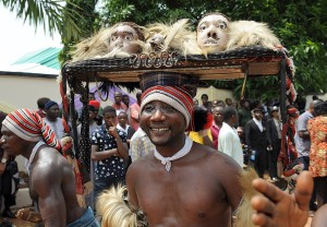 An Ohafia cultural troup entertains bystanders during the burial of Nigeria's secessionist leader Odumegwu Ojukwu at his native Nnewi country home, in Anambra State eastern Nigeria. Odumegwu Ojukwu, who championed the campaign for an independent Republic of Biafra in eastern Nigeria in the 1960s culminating in a 30-month civil war which left more than a million dead was buried at his Nnewi family home in Anambra State.
