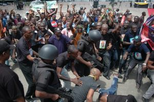 some-policemen-trying-to-stop-some-traders-from-the-arena