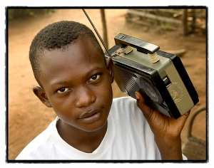 young-boy-listening-to-radio biafra